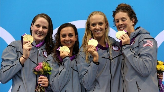 USA women pose with 4x100m Medley Relay medal - Gold medallists (L-R) Missy Franklin, Rebecca Soni, Dana Volmer, and Allison Schmitt of the United States pose on the podium during the medal ceremony for the Women's 4x100m Meldey Relay Final on Day 8.