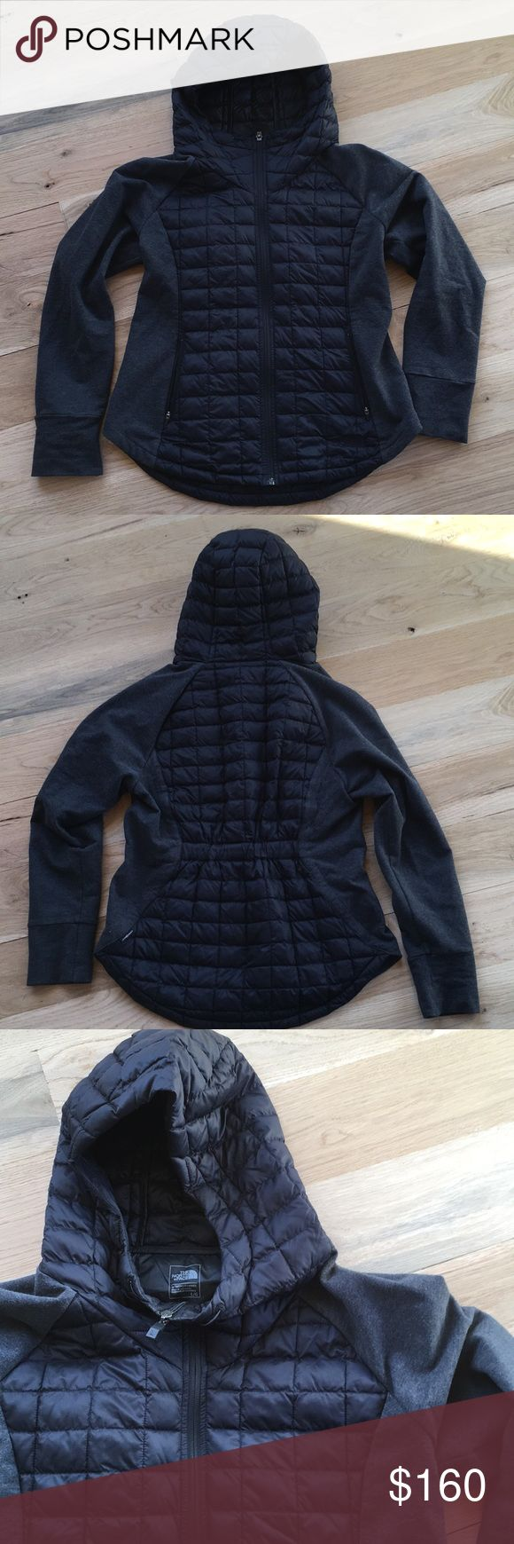 North Face Thermoball Jacket North Face Thermoball jacket. Black quilted body and hood with grey sweatshirt material sleeves. Jacket is very warm and great for layering over other winter items. Size large. The North Face Jackets & Coats