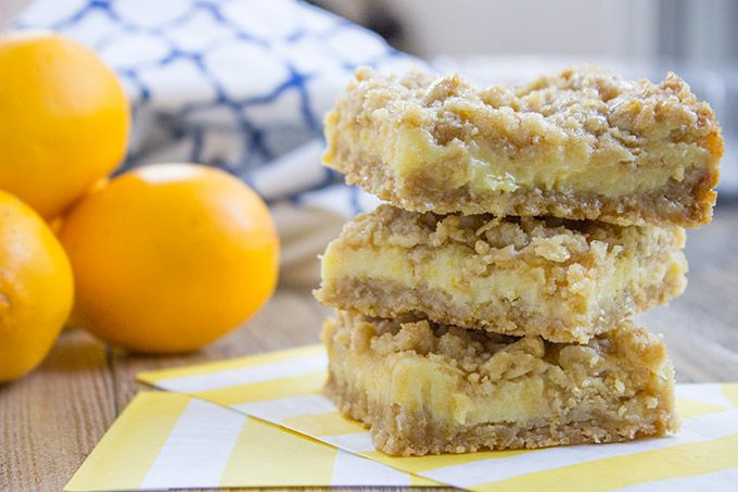 Easy Creamy Lemon Crumb Bars with a quick oatmeal crumb base and a sweet, tart creamy lemon filling that is a cross between lemon curd and lemon cheesecake.