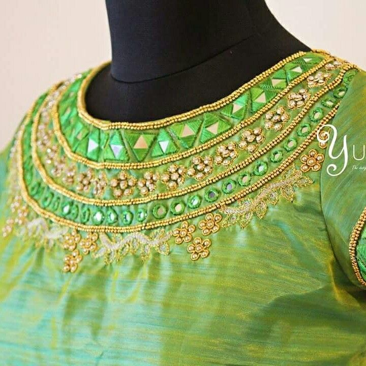 Hand embroidered mirror and zardosi work on boat neck designed on a Green Raw silk in contrast for a Ash Grey colour Kanchivaram Silk saree! For orders and enquiries reach us at 9789903599 / 04442179088. #greyandgreen #silkblouse #mirrorwork #zardosiembroidery #yuti #yutidesignerhouse #blouseembroidery #wedding #bridaltrousseau #yutiforbride