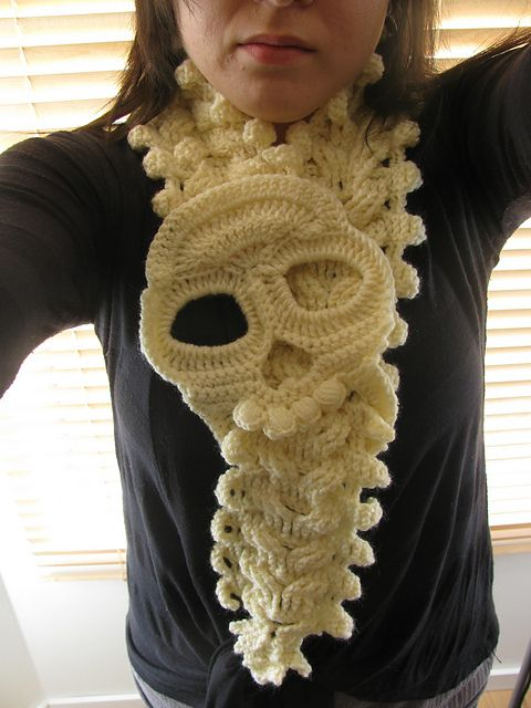 "Dingleballs and skulls were made for each other. Make this ""Spine Warmer"" your Dia de Los Muertos scarf.   Floriental's Spine Warmer on Ravelry"