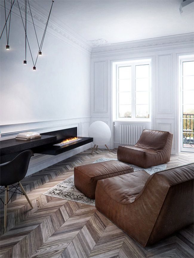 Living room by INT2 Architecture. Caption: Fireplace, herringbone wood flooring, leather sofa, Eames Plastic Armchair DAW.