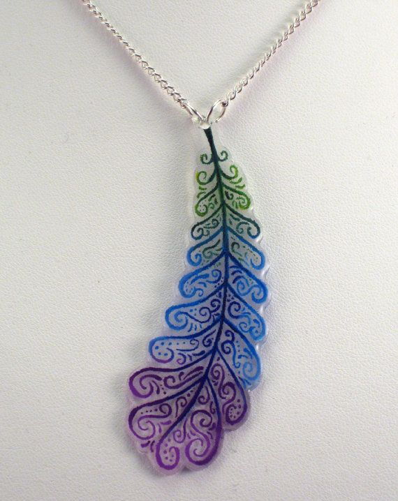 Items similar to Multicolored Feather Shrinky Dink Necklace on Etsy