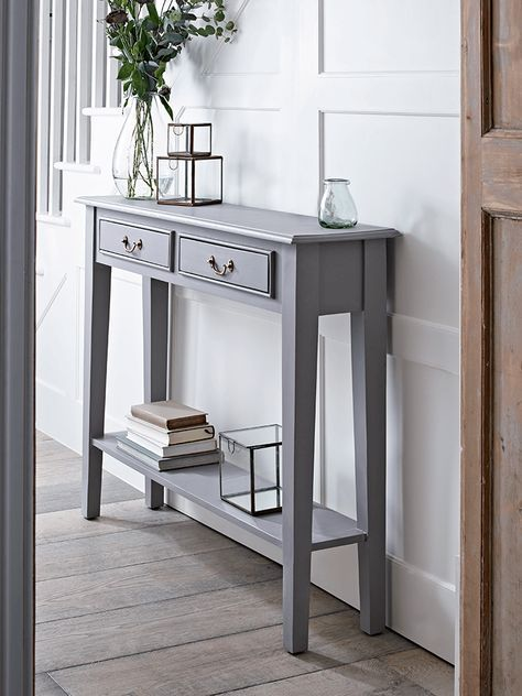 With a warm grey painted finish and two slender drawers with simple brass handles, this new version of our bestselling Limewashed Console Table is the perfect way to store essentials in your hallway or lounge. Each has a handy shelf for extra storage, and fits snugly against your wall.