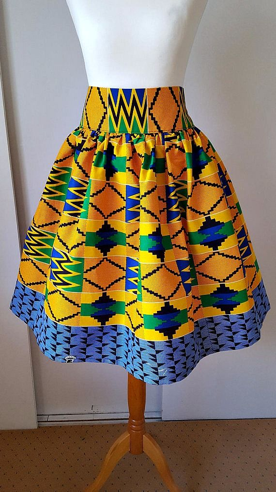 Lovely African print Knee / Calf length cotton skirt, High waist and elasticized waist on back, Gathering all around and elasticated back waist. Available in any size. Less than 22 inch to 51 inch or more. Kente Skirt Knee/Calf Length Kente African Skirt Printed Kente skirt African Clothing Ankara Maxi Skirt Ankara Print Kente Maxi Skirt.   Ghanaian fashion | Senegal fashion | Kenya fashion | Nigerian fashion (affiliate)
