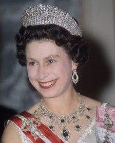 """The exquisitely crafted emerald and diamond encrusted Godman Necklace, which is part of Her Majesty Queen Elizabeth II's personal jewelery collection, was a gift by the two elderly Godman sisters to her majesty the Queen. The name""""Godman Necklace"""" reflects the name of the original owners of the necklace."""