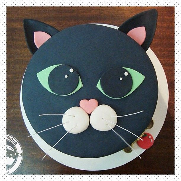 Going to make this cat, but in a brownish fondant for my new kitten...or maybe have half brown and the other half grey to represent my two cats                                                                                                                                                     More