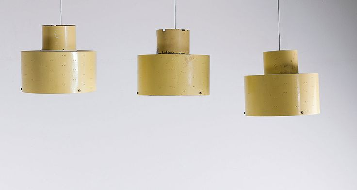 Paavo Tynell. Three 9069/24 ceiling lights, 1950s. H. 21 cm; D. 24 cm. Made by Taito Oy, Helsinki. Sheet metal, perforated in parts, painted yellow, matted glass.