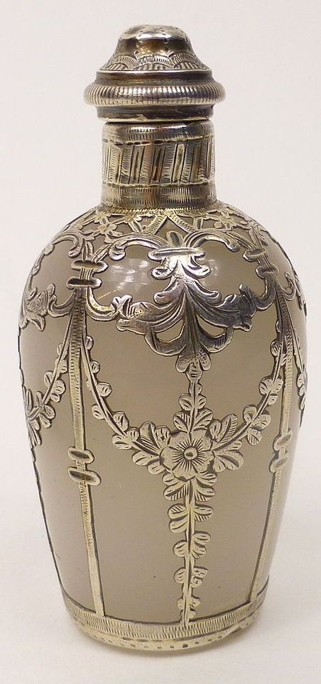 Victorian solid silver mounted glass scent perfume bottle.