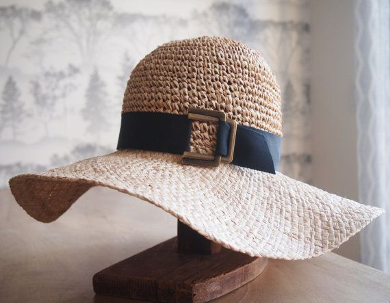 Pippa: Straw floppy hat with crocheted crown with black grosgrain trim and antique brass closure