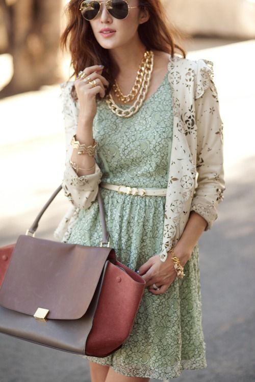 white lasercut blazer on mint green lace dress with gold accessories