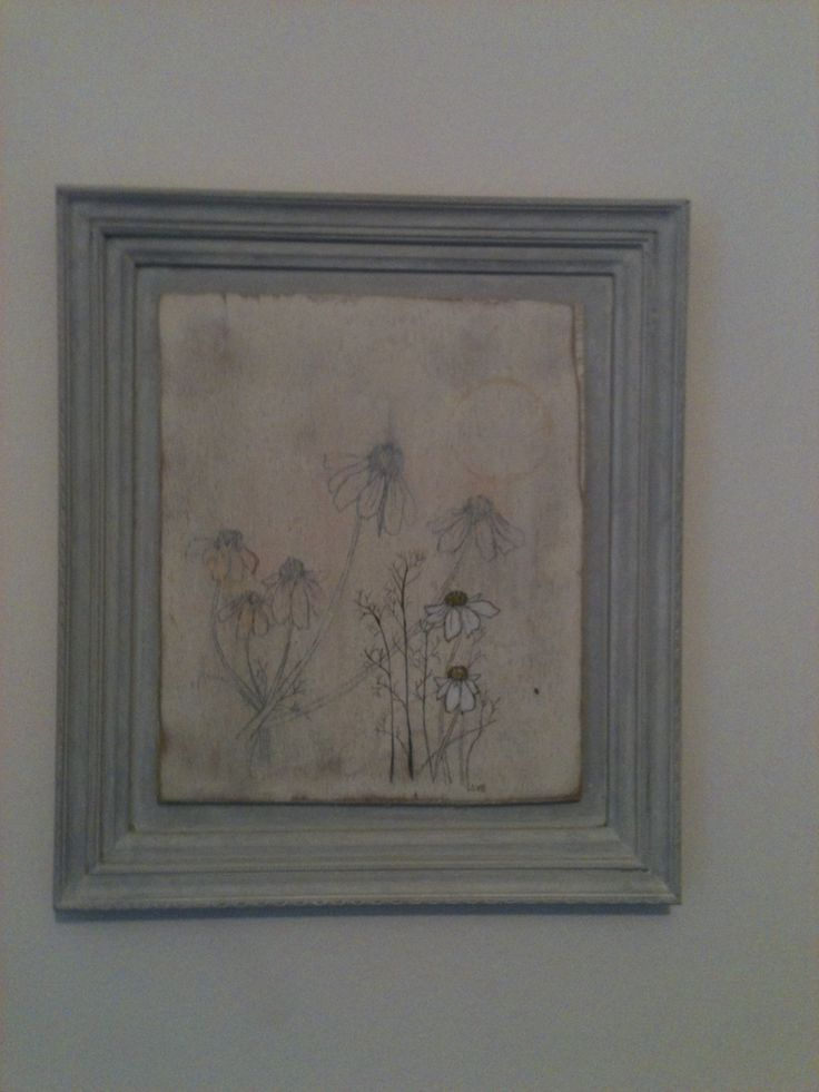 An illustration of camomile on gessoed board, I also made the frame.