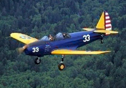 """Fairchild PT-19 Cornell trainer.N52164,flown by Ken Dorsch & owned by Curt Kinchen(now John Armbrust)With wing loading roughly 43% higher than Stearman PT-13,Fairchild had higher stall & required more care at low speed,making it what Army looking for,trainer that would more nearly resemble fighter aircraft trainees would eventually fly.Following evaluation,USAAC ordered 270,with 2 open cockpits,as PT-19 """"Cornell,"""" powered by Ranger L-440 6-cylinder,inverted,air-cooled inline engine 175Hp ."""