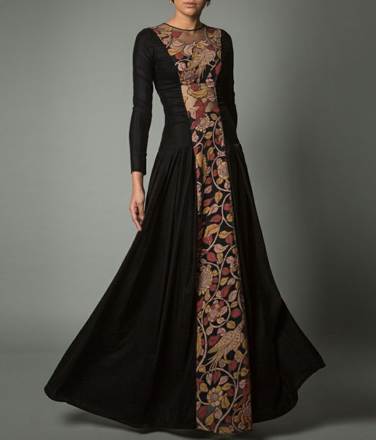 A stunning onyx floor length dress with net inserts on the front panel and upper back. It is embellished with kalamkari patchwork. A matching velvet bustier and pants complete the ensemble. Neeta Lulla.