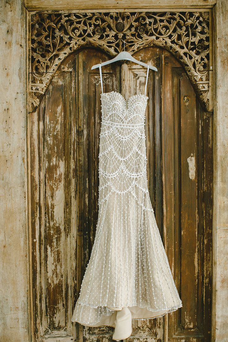Deco wedding dress - Yefta Gunawan Couture cream wedding gown adorned with intricate pearl detailing // Magical Bali Wedding on a Floating Stage: Aldi and Juliana