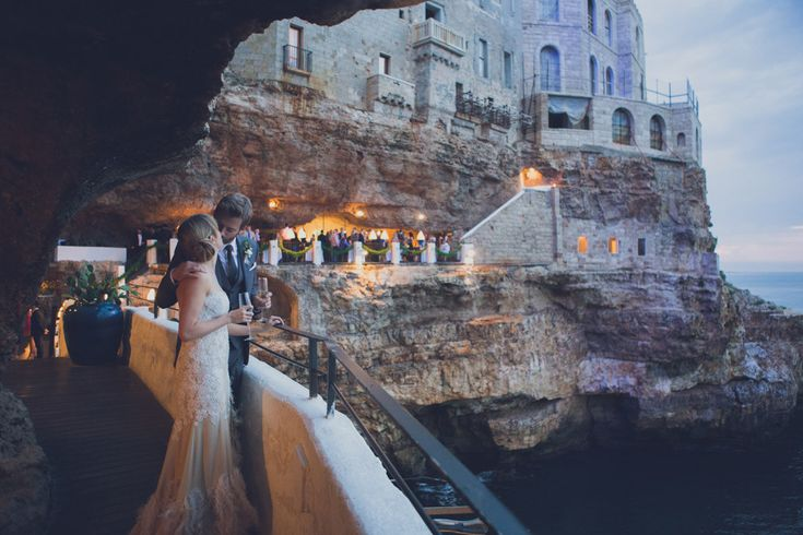 Bespoke Wilden Bride Wedding Dress For A Contemporary Wedding In Italy At The Hotel Grotta Palazzese With Groom In Bespoke Suit By A Suit That Fits And Images From Pickavance Weddings