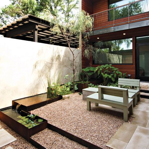 Courtyard wall leading into house, gravel,look at the scale, metal sided water feature. (Wood on the house is a little to red.) Houzz, http://www.houzz.com/photos/551205/Courtyard-modern-landscape-austin#