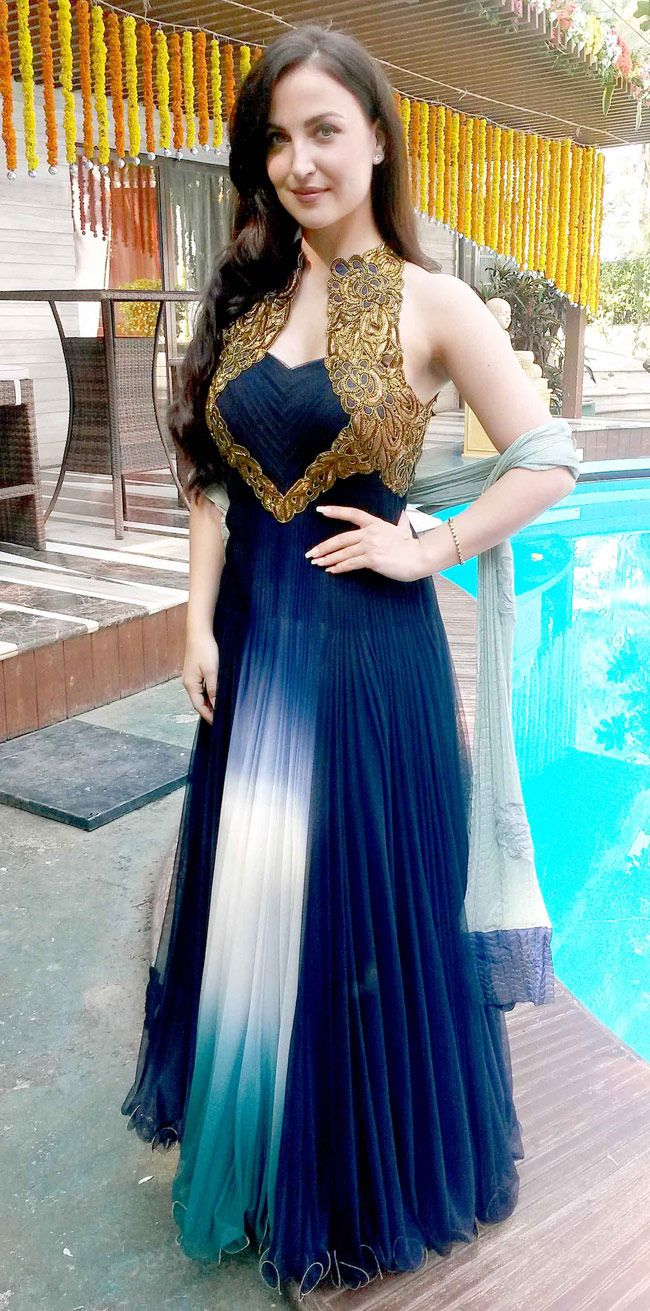 Elli Avram in a blue-golden gown on the sets of Abbas-Mustan's next. #Bollywood #Fashion #Style #Beauty