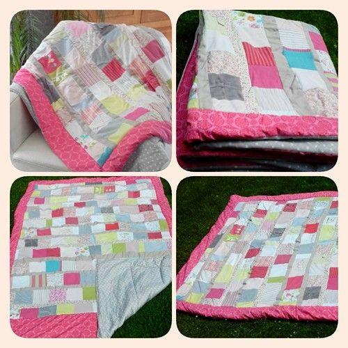 Quilt made of babyclothes of my daughter. Sprei / plaid gemaakt met babyklerrtjes van mijn dochter.  Meer dan 140 lapjes, 12 rijen met stroken ertussen.