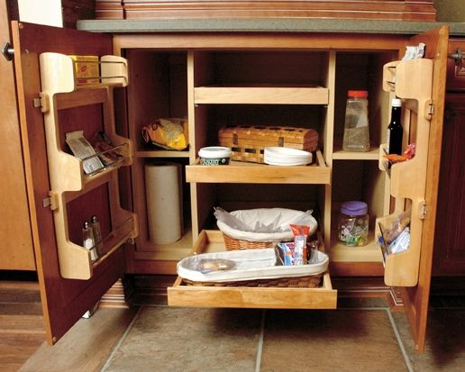 Super chef cabinet with door shelf kit installed into standard base cabinet. Wellborn Cabinets.