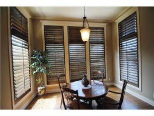 White trim. Wood blinds