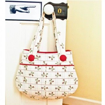 The Pretty Pinafore Purse PDF pattern, from U*handbag.  Isn't this just the cutest thing ever?