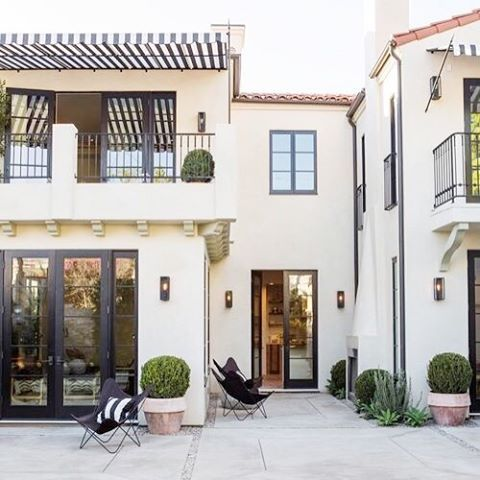 Outdoor inspiration! Stucco walls, terracotta roof tiles, and Chateau-Marmont inspired striped canvas awnings!Designed by Leigh Herzig, photo by Laure Joliet via @remodelista #leighherzig #interiordesign