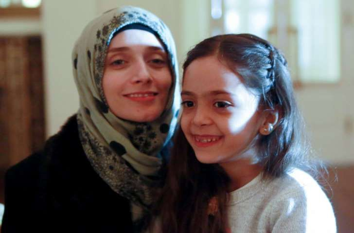 Syrian girl Bana al-Abed (R), known as Aleppo's tweeting girl, poses with her mother Fatemah during an interview in Ankara, Turkey, on December 22, 2016. The young Syrian girl was one of thousands of people evacuated from once rebel-held areas of Aleppo in the last days under a deal brokered by Turkey and Russia. She was evacuated on Monday and Turkish officials promised then she would come to Turkey with her family. But it was not clear when she had crossed over. / ADEM ALTAN/AFP/Getty…