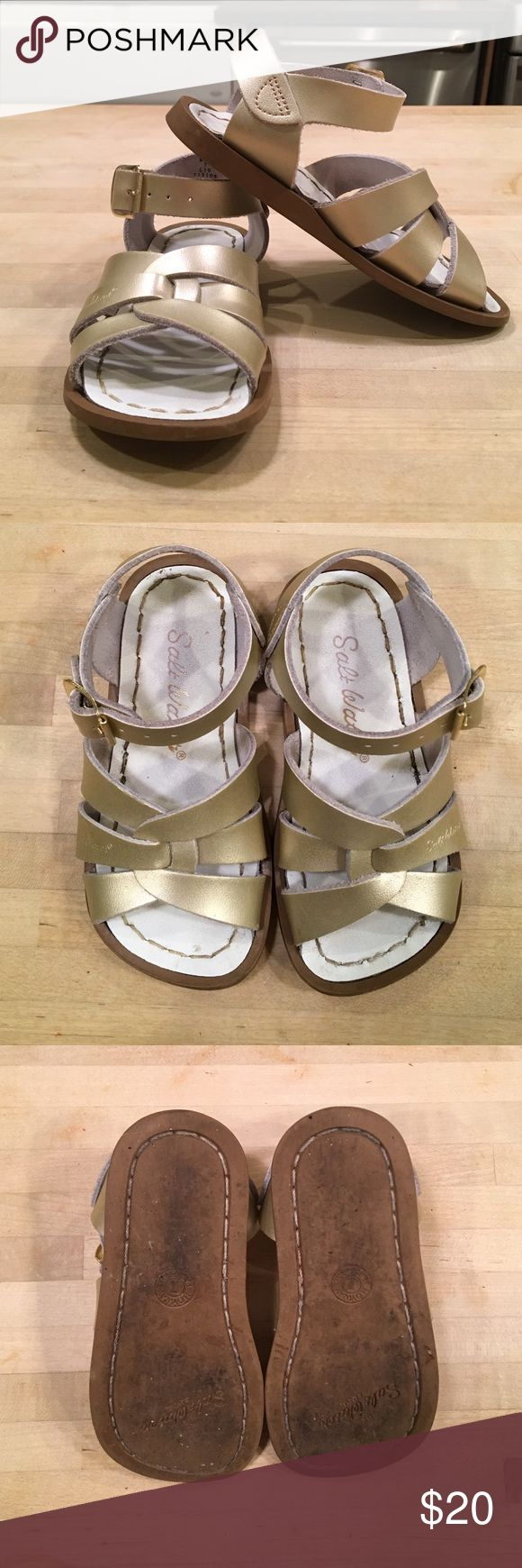 Gold Saltwater Sandals 7 GUC Gold Saltwater Sandals - size 7 for a toddler/young kid - fantastic sandals that are meant to get wet, have good traction, stay on well and are cute - good used condition with some wear on the soles Salt Water Sandals by Hoy Shoes Sandals & Flip Flops