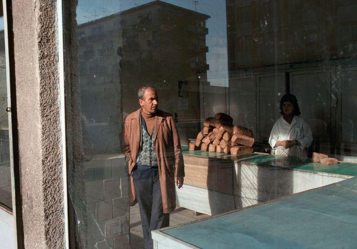 Martin Parr - Tirana. Looking inside the bakery. 1990.