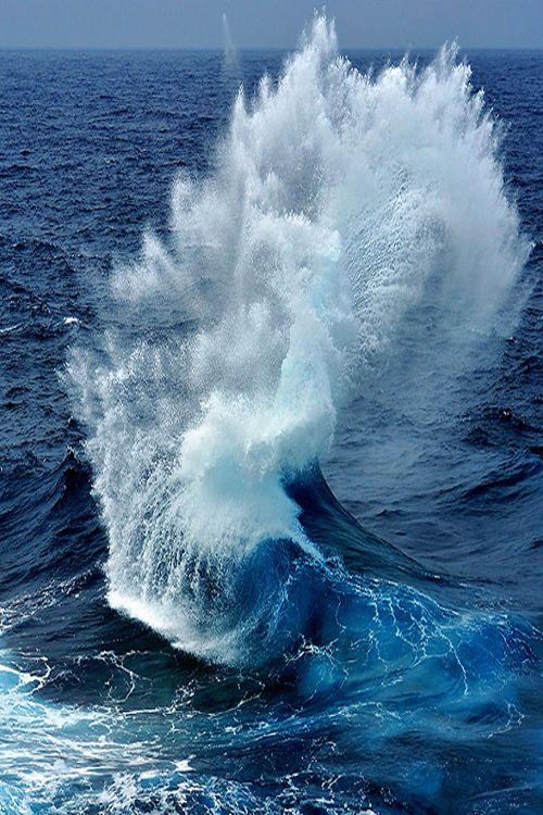 Huge plume of water rises high when it hit rock near shore