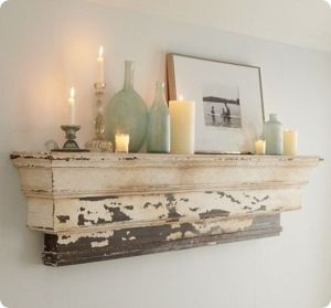 mantelpiece-looking shelf with candles by Tina. Alexander