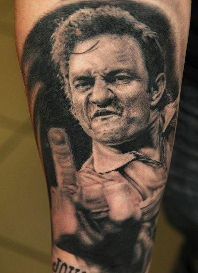 Love this wild Johnny Cash portrait tattoo! If you guys can help us credit the artists, it would be great!
