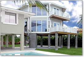Hurricane proof two-story stilt house design built in the Florida Keys with panoramic views by Topsider Homes