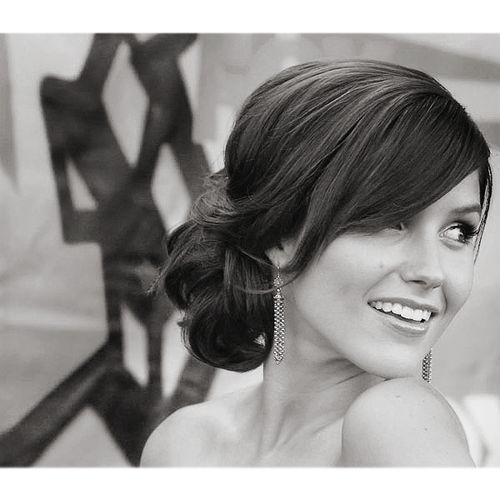 side bun. Nice for wedding day. Not all up and not on your neck either. Good fo those summer weddings!