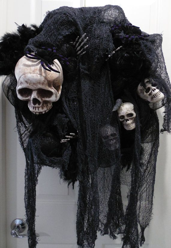 Decorate your front door with this Spooky and Sinister Skull Wreath for Halloween. This Large wreath is made on a 18 wire work wreath and measures 23
