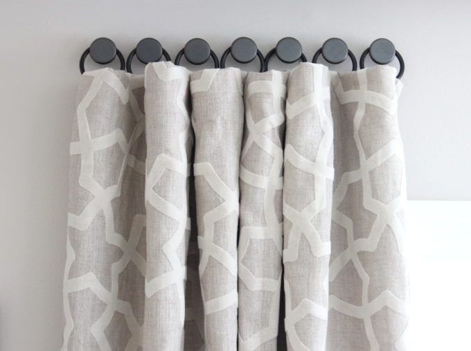 A Solution For Hanging Curtains On Tricky Windows - Shine Your Light. This method allows you to hang the rings on various walls with an angle situation like I have, and lets the curtain curve as needed.
