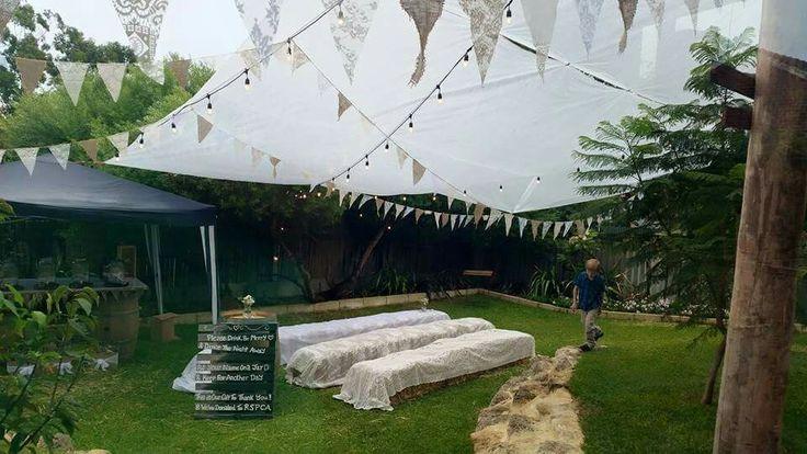 Bunting, hay bails, lace, backyard wedding rain!