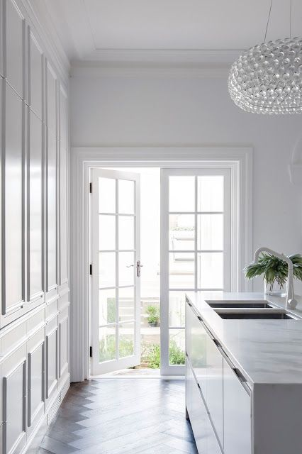 A Kitchen that Almost Disappears:               Had to be striking ·               Parisian Style ·               Rarely cooked at home ·               Good transition and work flow thru the terrace ·               Did not want to see appliances ·               Good use of light both natural and artificial ·               Central hub of the home