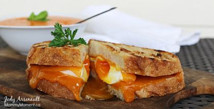 Poached Egg Grilled Cheese Sandwich | From Mommy Moment | #Eggs #GetCracking Take everyone's favourite rainy day comfort food to new heights. This recipe for grilled cheese is made special with sourdough bread, cheddar cheese, and a poached egg. Enjoy the sandwich with a cup of warm red pepper soup for the ultimate comforting meal.