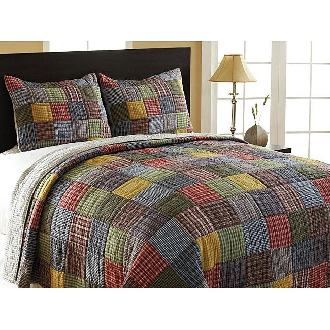 this cozy bedding set features patchwork design on one side and a blue white pinstripe