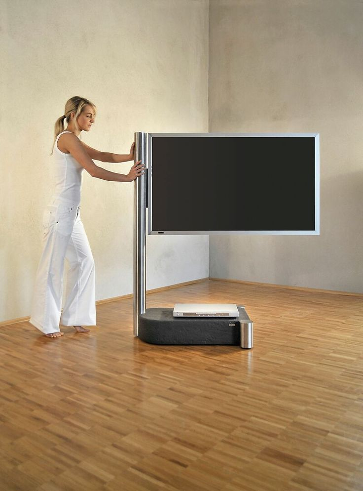 """TV holder as free-standing version for flat-screens from 37"""" bis 60"""".  The integrated casters (if ordered) allow this model to be rolled smoothly and easily through the room.  Concealed cable management.  Concealed storage space in the vertical column for cables and multiple sockets."""