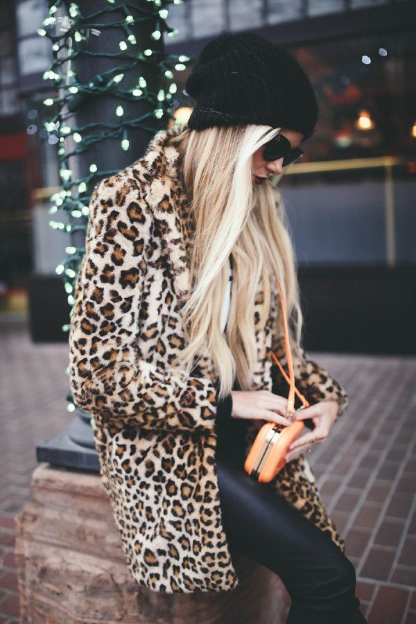 Animal print coat, leather leggings, and a beanie.