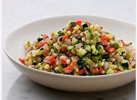 Corn Succotash - recipe similar to the Cheesecake Factory's corn succotash  1 1/2 cups frozen corn kernels, thawed  1/2 cup chopped onion  1 cup chopped summer squash and/or zucchini  1 cup chopped red bell pepper  1 tsp. ground cumin  1 T olive oil  2 garlic cloves, minced  1/2  cup defatted chicken broth  2 T chopped fresh cilantro  1/8 tsp. hot sauce  1/8 tsp. ground pepper  2 cups frozen baby lima beans, thawed (optional)   In a large skillet over high heat, saute corn, red pepper…