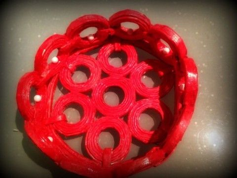 Tutorial to recycle the newspaper into the beautiful red baskets..by Anu Kaushik