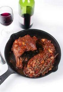 Coq au vin cuit à l'armagnac