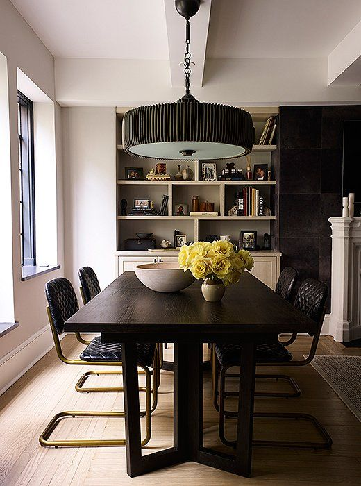 Living Room Sets For Apartments Cheap Design Tour A Nyc Apartment That Proves The Simple Beauty Of Black White And Gray Dining Table Chandeliers