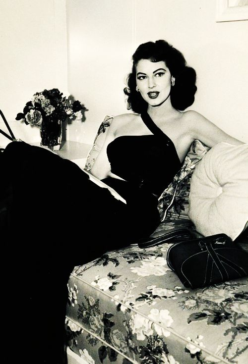 Ava Gardner (1949). Classic Hollywood, love this! late 40s early 50s hollywood movie star glam long black dress evening formal strapless unique cross front one side