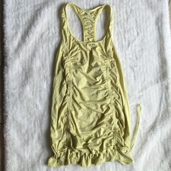 Lululemon Yellow Tank Top Size 8 Preowned and in good condition Lululemon Yellow Tank Top Size 8. No pads or builtin bra. It can be scrunched at the bottom or let loose. Please look at pictures for better reference. Happy shopping! lululemon athletica Tops Tank Tops