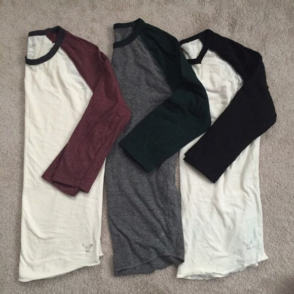 Pre-bundled AEO Baseball Tees These are mens tees and yes I wore them! I loved these baseball tees paired with distressed boyfriend jeans and converse... So cute! There is some slight pilling in the arm pits and from washing, but still have a lot of life left! If you like a mix of masculine/feminine style, add these to your wardrobe!  Make me an offer :) These are supposed to be 3/4 sleeves for men, but would probably need to push the sleeves up slightly if you have short arms like me. :)…